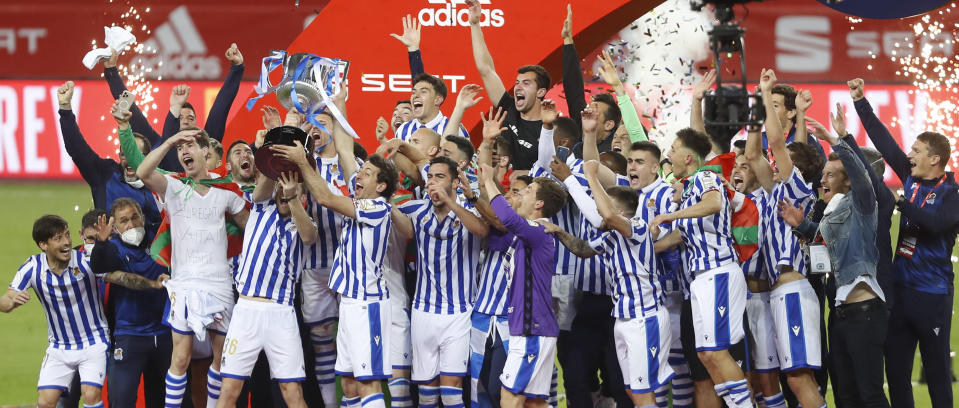 Real Sociedad players celebrate with the cup after winning the final of the 2020 Copa del Rey, or King's Cup, soccer match between Athletic Bilbao and Real Sociedad at Estadio de La Cartuja in Sevilla, Spain, Saturday April 3, 2021. The game is the rescheduled final of the 2019-2020 competition which was originally postponed due to the coronavirus pandemic. (AP Photo/Angel Fernandez)