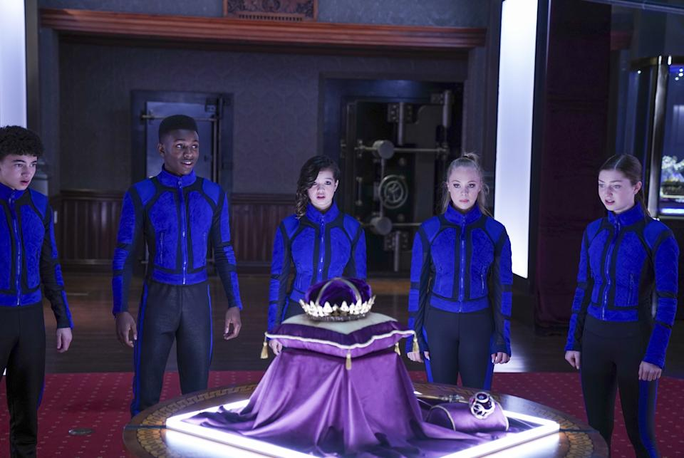 The society convene in a still from Disney's <i>Secret Society of Second-Born Royals.</i> (Disney+)
