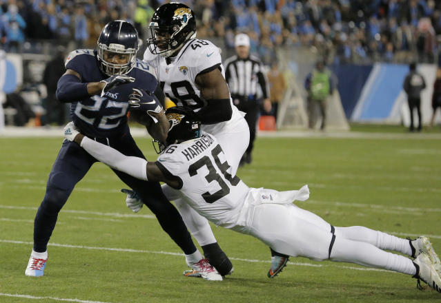 Tennessee Titans running back Derrick Henry (22) breaks a tackle by Jacksonville Jaguars defensive back Ronnie Harrison (36) during the first half of an NFL football game, Thursday, Dec. 6, 2018, in Nashville, Tenn. Henry scored a touchdown on the play. (AP Photo/James Kenney)