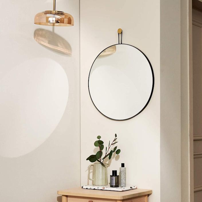 <p>This <span>Harmati Round Mirror</span> ($55) will make a sleek and minimal addition above your couch.</p>