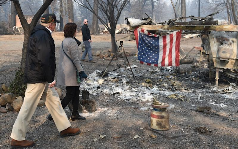 Image result for Trump visits fire-wracked California as more than 1,000 missing