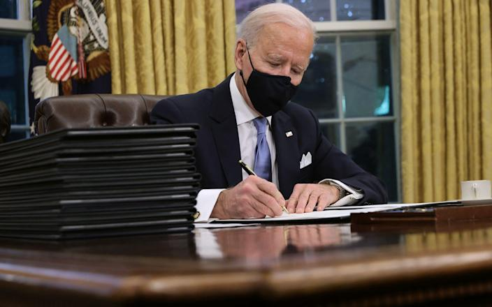 Biden signs his first executive orders as President - GETTY IMAGES