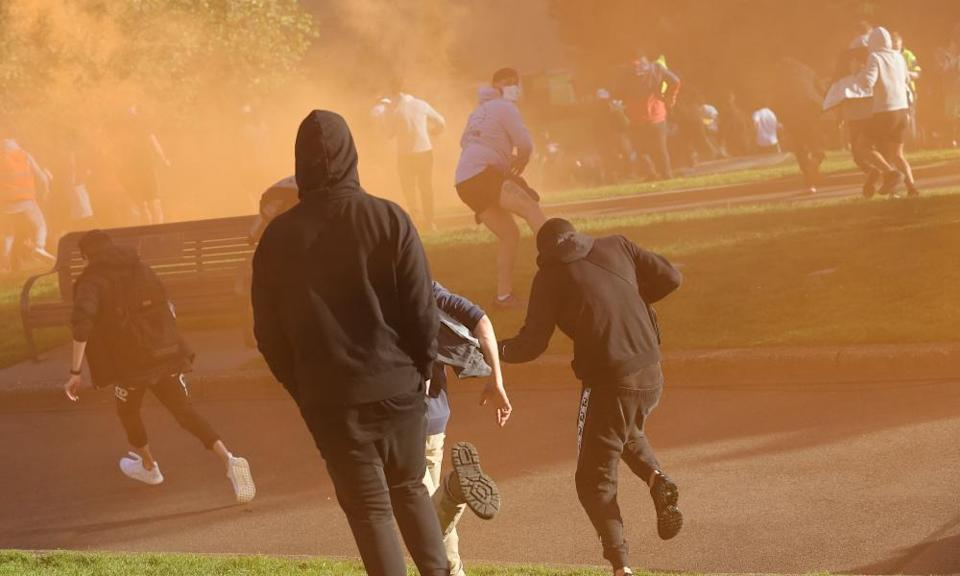Demonstrators react after police fire teargas around Melbourne's Shrine of Remembrance