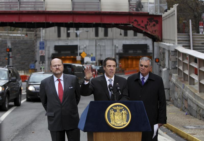New York Governor Andrew Cuomo, center, speaks at a news conference while United States Secretary of Transportation Ray LaHood, right, and MTA Chairman Joseph Lhota look on in front of the Hugh L. Carey Tunnel, formerly the Brooklyn-Battery Tunnel,  in New York, Tuesday, Nov. 13, 2012. Cuomo announced the the tunnel, which was closed from damage caused by Superstorm Sandy, will open to limited traffic. (AP Photo/Seth Wenig)