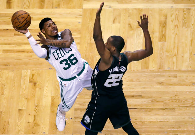 Celtics guard Marcus Smart (36) is fouled by Bucks forward Khris Middleton during the second half of Game 5 Tuesday night. (AP)