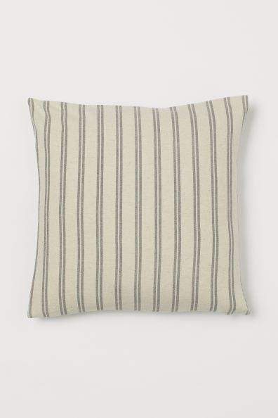 <p>This <span>H&amp;M Cotton-Blend Cushion Cover</span> ($10) is great for minimal spaces.</p>