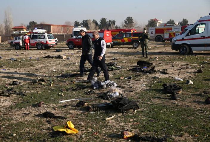 Emergency crew check site where the Ukraine International Airlines plane crashed after take-off from Iran's Imam Khomeini airport, on the outskirts of Tehran