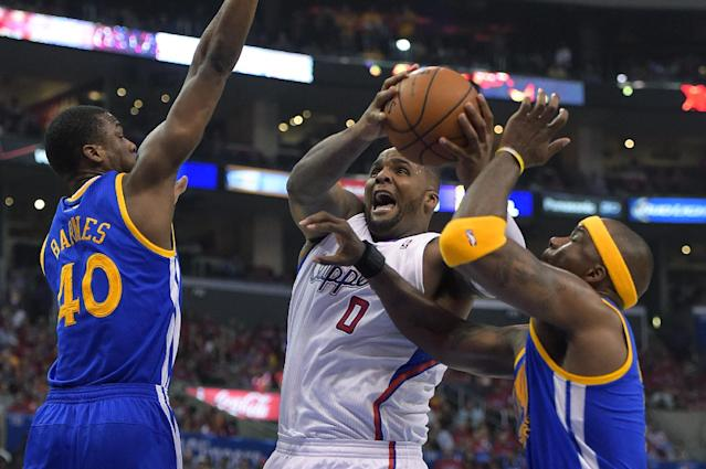 Los Angeles Clippers forward Glen Davis, center, goes up for a shot as Golden State Warriors forward Harrison Barnes, left, and center Jermaine O'Neal defends during the first half in Game 7 of an opening-round NBA basketball playoff series, Saturday, May 3, 2014, in Los Angeles. (AP Photo/Mark J. Terrill)