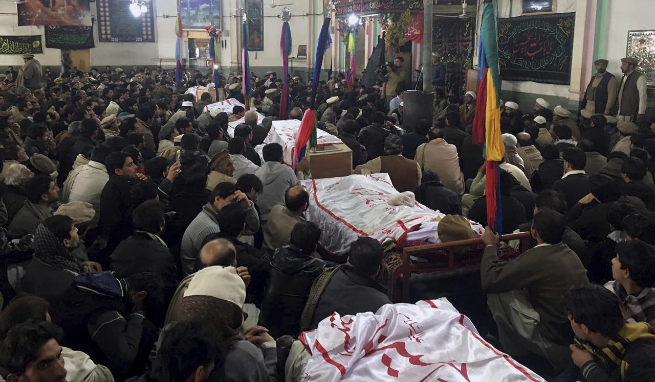 <p> Pakistani Shiite Muslims attend the funeral prayer of the victims of bomb blast at a mosque in Parachinar, the capital of Pakistan's Kurram tribal region, Saturday, Jan. 21, 2017. A bomb exploded in a market in a northwest tribal region that borders Afghanistan, killing more than 20 and wounding dozens. The explosion took place when the market was crowded with retailers buying fruits and vegetables from a wholesale shop, officials said. (AP Photo/Ali Murtaza) </p>