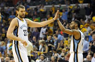 Marc Gasol touches base with Mike Conley, same as always. (Frederick Breedon/Getty Images)