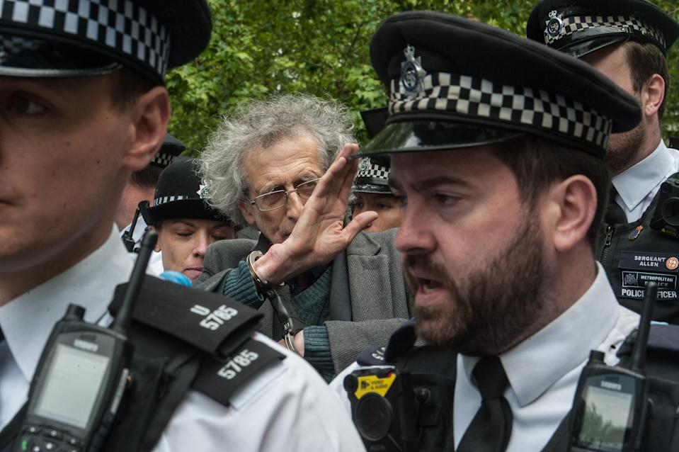 LONDON, ENGLAND - MAY 16: Piers Corbyn (brother of former Labour leader Jeremy Corbyn) is arrested as conspiracy theorists gather at Hyde Park Corner to defy the emergency legislation and protest their claim that the Coronavirus pandemic is part of a secret conspiracy on May 16, 2020 in London, United Kingdom. The prime minister has announced the general contours of a phased exit from the current lockdown, adopted nearly two months ago in an effort curb the spread of Covid-19. (Photo by Guy Smallman/Getty images)