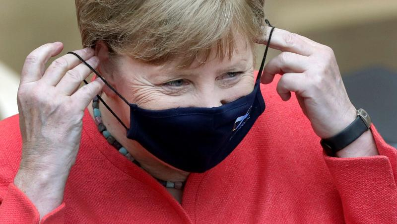 German Chancellor Angela Merkel adjusts her face mask as she arrives for a meeting of the upper house of the German legislative in Berlin, Germany, Friday, July 3, 2020. (AP Photo/Michael Sohn) (Photo: ASSOCIATED PRESS)
