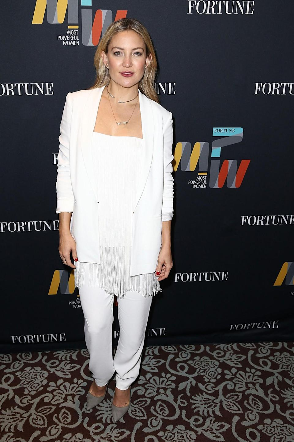 <p>Kate's donned an all-white trouser suit on numerous occasions, most recently at the Fortune Most Powerful Women Summit event in LA last month. </p>