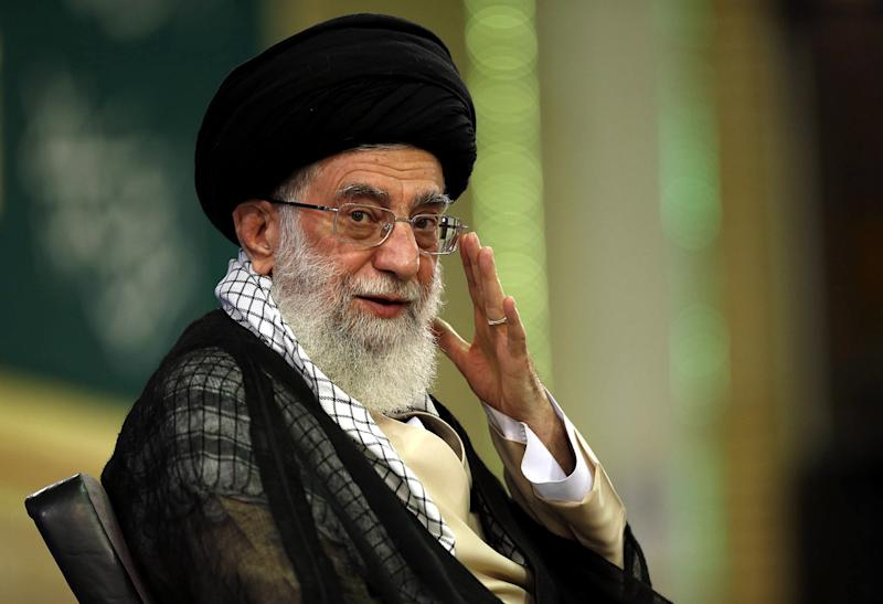This photo provided by the office of Iran's supreme leader, Ayatollah Ali Khamenei, shows him arriving for a meeting in Tehran on September 7, 2014 (AFP Photo/)