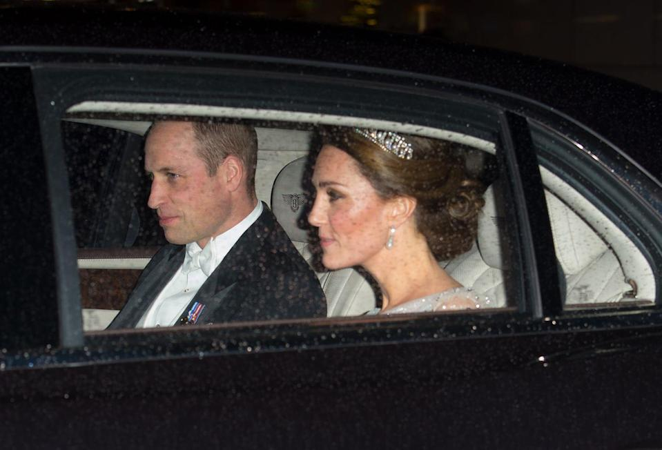 """<p>Prince William and Duchess Kate arrived at the reception at Buckingham Palace. The Duchess of Cambridge <a rel=""""nofollow noopener"""" href=""""https://www.townandcountrymag.com/society/tradition/a10302981/cambridge-love-knot-tiara/"""" target=""""_blank"""" data-ylk=""""slk:wore the Lover's Knot tiara"""" class=""""link rapid-noclick-resp"""">wore the Lover's Knot tiara</a>, one of her favorite tiaras. </p>"""