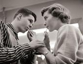 <p>These two young lovebirds lock eyes as they share an ice cream soda. </p>