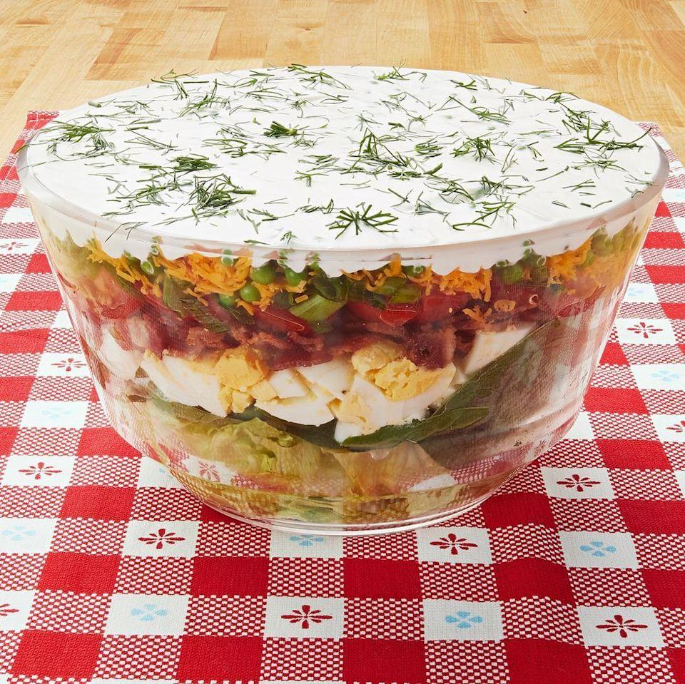 """<p>This layered beauty can be made ahead of time, saving you a few minutes come Easter Sunday. Add the creamy dressing when you're ready to serve.</p><p><span><a href=""""https://www.thepioneerwoman.com/food-cooking/recipes/a10214/layered-salad/"""" rel=""""nofollow noopener"""" target=""""_blank"""" data-ylk=""""slk:Get the recipe."""" class=""""link rapid-noclick-resp""""><strong>Get the recipe.</strong></a></span></p><p><span><a class=""""link rapid-noclick-resp"""" href=""""https://go.redirectingat.com?id=74968X1596630&url=https%3A%2F%2Fwww.walmart.com%2Fsearch%2F%3Fquery%3Dsalad%2Bbowls&sref=https%3A%2F%2Fwww.thepioneerwoman.com%2Ffood-cooking%2Fmeals-menus%2Fg35585877%2Feaster-recipes%2F"""" rel=""""nofollow noopener"""" target=""""_blank"""" data-ylk=""""slk:SHOP SALAD BOWLS"""">SHOP SALAD BOWLS</a><br></span></p>"""