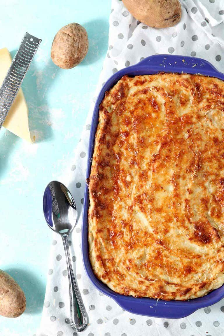 """<p>Warning: Once you make this <a href=""""https://www.countryliving.com/food-drinks/g2696/mashed-potato-recipes/"""" rel=""""nofollow noopener"""" target=""""_blank"""" data-ylk=""""slk:mashed potato recipe"""" class=""""link rapid-noclick-resp"""">mashed potato recipe</a>, you'll never be making another version again. It's completely life changing.</p><p><strong>Get the recipe at <a href=""""https://www.thespeckledpalate.com/garlic-parmesan-mashed-potato-casserole/"""" rel=""""nofollow noopener"""" target=""""_blank"""" data-ylk=""""slk:The Speckled Palate"""" class=""""link rapid-noclick-resp"""">The Speckled Palate</a>.</strong> </p>"""