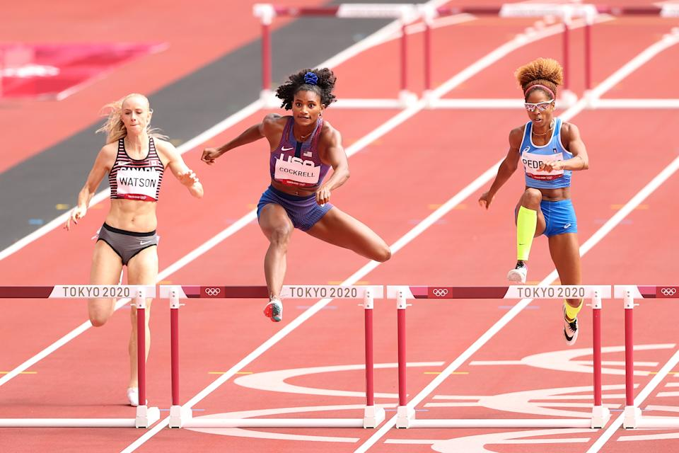 TOKYO, JAPAN - JULY 31: Anna Cockrell (center) of Team United States competes against Sage Watson of Team Canada and Yadisleidis Pedroso of Team Italy in the Women's 400m Hurdles Round 1 - Heat 1 on day eight of the Tokyo 2020 Olympic Games at Olympic Stadium on July 31, 2021 in Tokyo, Japan. (Photo by Christian Petersen/Getty Images)