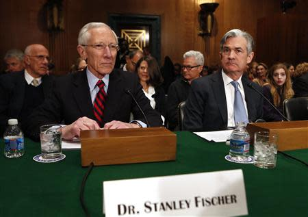 Stanley Fischer (L), the former chief of the Bank of Israel, prepares to testify before the Senate Banking Committee confirmation hearing on his nomination to be a member and vice chairman of the Federal Reserve Board of Governors on Capitol Hill in Washington March 13, 2014. REUTERS/Yuri Gripas