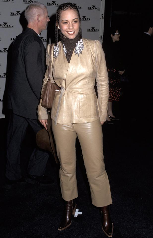 The following year at the 43rd Annual Grammy Awards, the singer went for a beige-and-brown leather ensemble at BMG's post-Grammys party.
