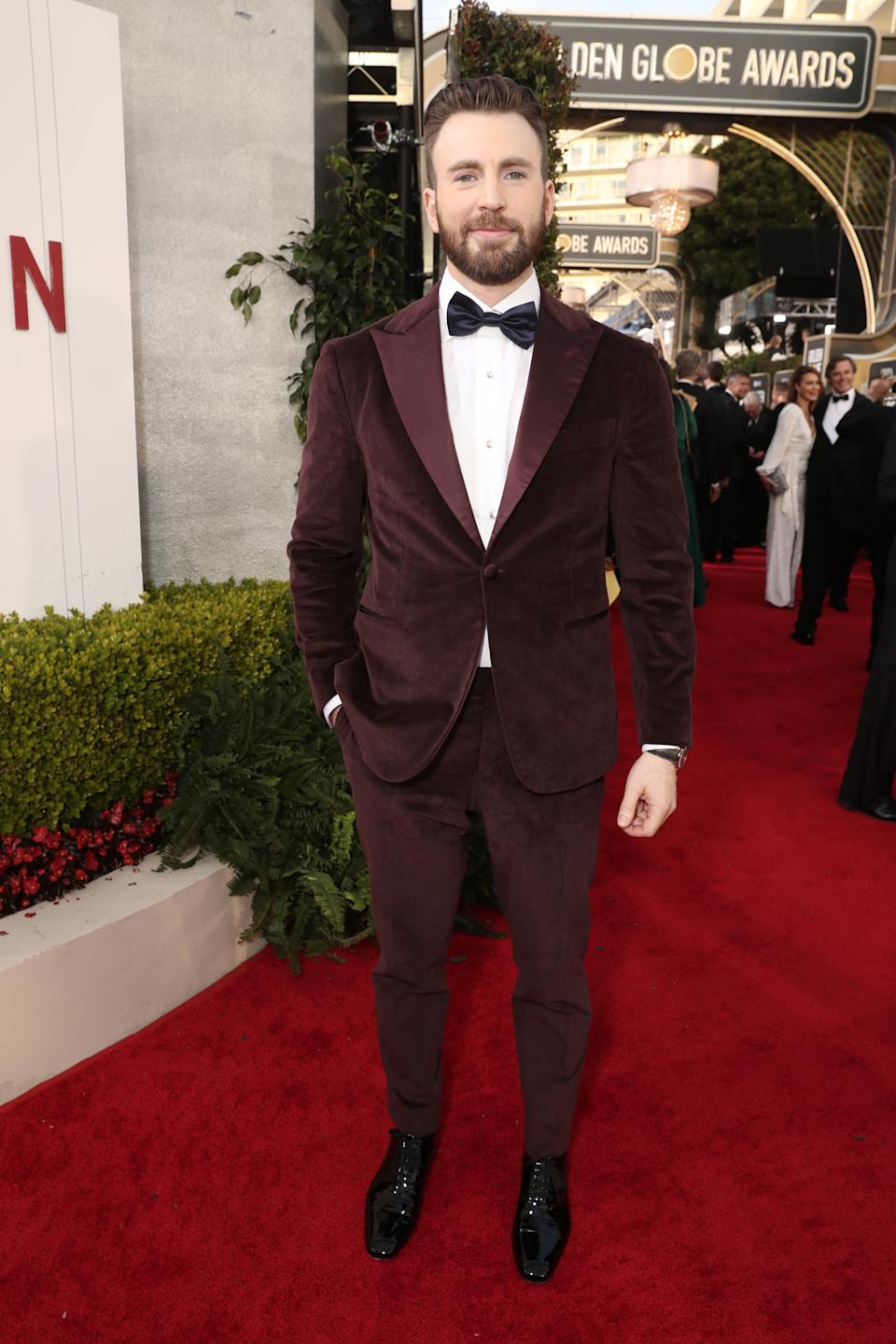 """Evans opted for a brown velvet suit to support his nominated film """"Knives Out."""" (Photo by: Todd Williamson/NBC/NBCU Photo Bank via Getty Images)"""