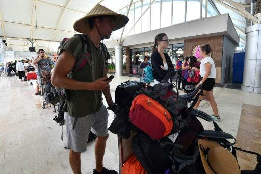 Tourists queue to depart from Lombok International Airport