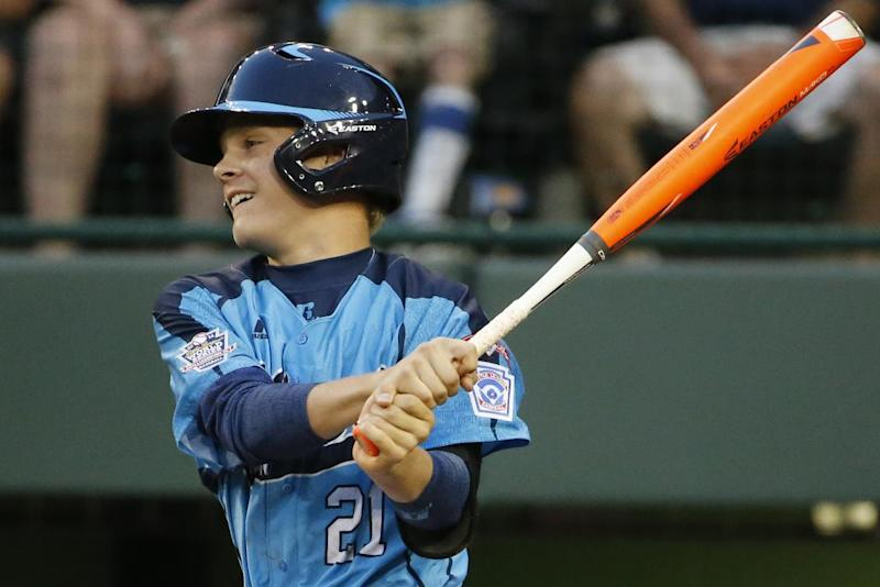 Las Vegas' Austin Kryszczuk (21) drives in a run with a triple off Philadelphia pitcher Mo'ne Davis in the first inning of a United States semi-final baseball game against Las Vegas at the Little League World Series tournament in South Williamsport, Pa., Wednesday, Aug. 20, 2014. (AP Photo/Gene J. Puskar)