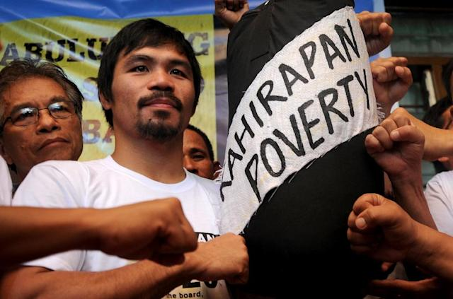 Rags-to-riches Philippine idol Manny Pacquiao has previously said his greatest fight is to battle poverty (AFP Photo/Noel Celis)