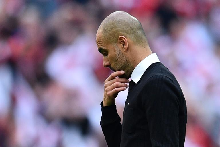 Manchester City's manager Pep Guardiola suffers defeat after the FA Cup semi-final football match against  Arsenal at Wembley stadium in London on April 23, 2017