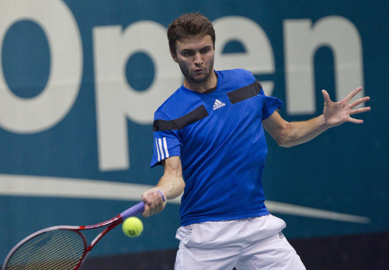 Gilles Simon of France returns a shot against Tomas Berdych of the Czech Republic during their semifinal match of the Thailand Open tennis tournament in Bangkok, Saturday, Sept. 28, 2013. (AP Photo/Sakchai Lalit)