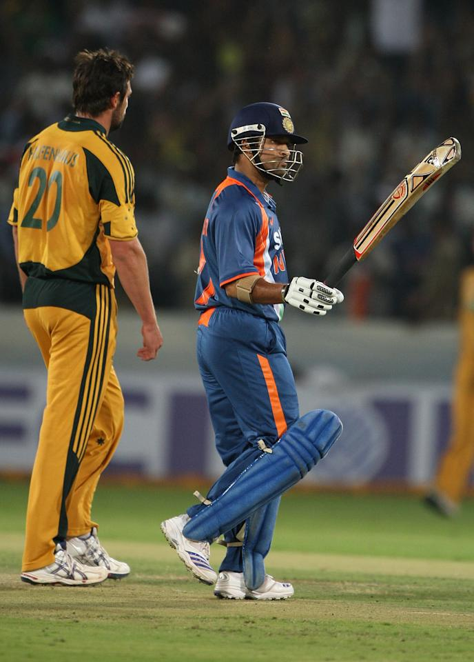 HYDERABAD, INDIA - NOVEMBER 05:  Sachin Tendulkar of India calls for a change of bat after reaching the 17000 one day international run mark during the fifth One Day International match between India and Australia at Rajiv Gandhi International Cricket Stadium on November 5, 2009 in Hyderabad, India. Tendulkar is the first player in history to reach the milestone.  (Photo by Mark Kolbe/Getty Images)
