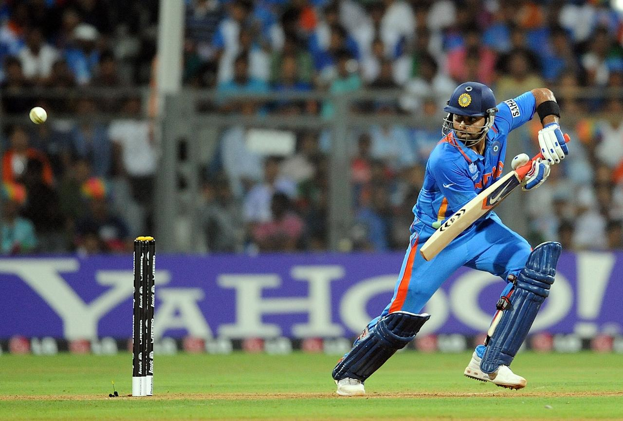 India batsman Virat Kohli plays a shot during the ICC Cricket world Cup final match between India and Sri Lanka at The Wankhede Stadium in Mumbai on April 2, 2011. AFP PHOTO / Prakash SINGH (Photo credit should read PRAKASH SINGH/AFP/Getty Images)