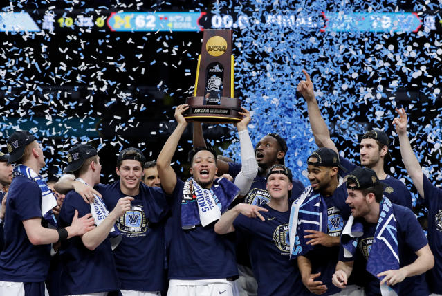 Villanova players celebrate with the trophy after beating Michigan 79-62 in the championship game of the Final Four NCAA college basketball tournament, Monday, April 2, 2018, in San Antonio. (AP Photo/David J. Phillip)