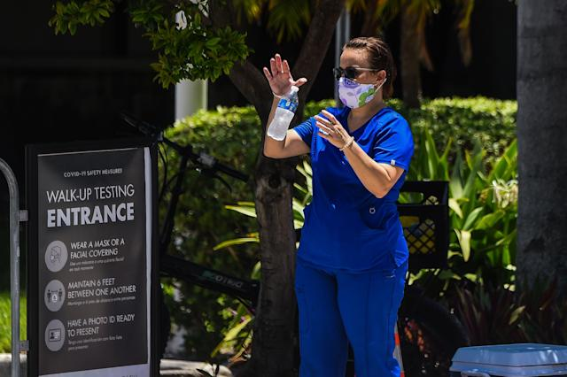 A woman waits for a coronavirus test in Florida, which on Wednesday reported its highest number of coronavirus infections so far. (Chandan Khanna/AFP via Getty Images)