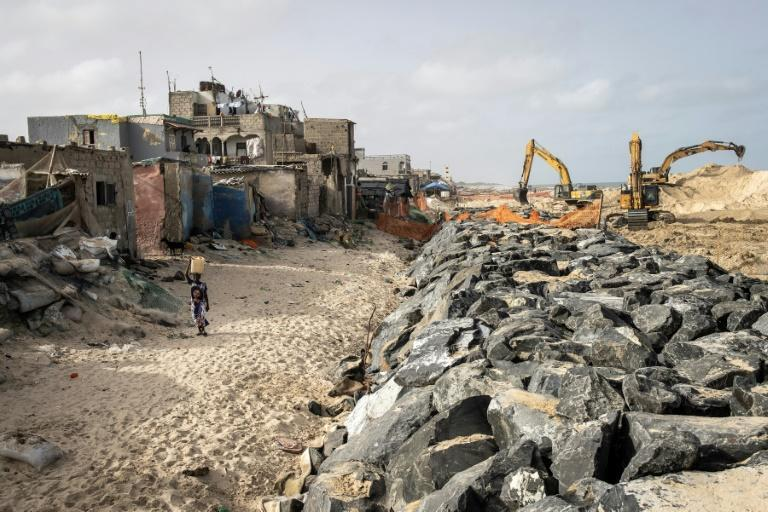 The Senegalese city of Saint-Louis is building a wall along the coast to try to keep the sea at bay (AFP/JOHN WESSELS)