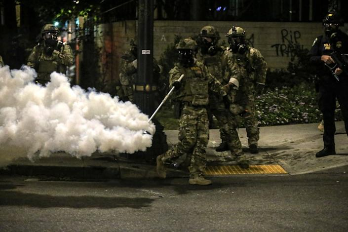 Militarized federal agents deployed by the president to Portland, fired tear gas against protesters again overnight Friday, July 17, 2020 in Portland, Ore. as the city's mayor demanded that the agents be removed and as the state's attorney general vowed to seek a restraining order against them.(Dave Killen/The Oregonian via AP)
