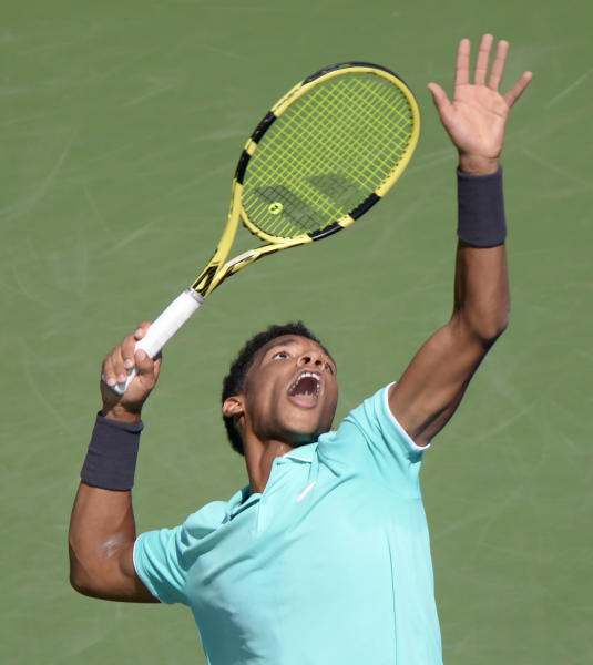 Canada's Felix Auger-Aliassime serves to Russia's Karen Khachanov during the Rogers Cup men's tennis tournament Thursday, Aug. 8, 2019, in Montreal. (Paul Chiasson/The Canadian Press via AP)