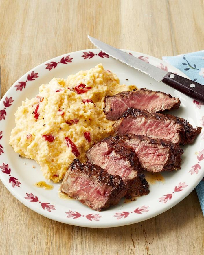 """<p>Enjoy a rich, hearty dinner of steak and grits that your family will devour.</p><p><strong><a href=""""https://www.thepioneerwoman.com/food-cooking/recipes/a32405191/spicy-steak-with-pimiento-cheese-grits-recipe/"""" rel=""""nofollow noopener"""" target=""""_blank"""" data-ylk=""""slk:Get the recipe."""" class=""""link rapid-noclick-resp"""">Get the recipe.</a></strong> </p>"""