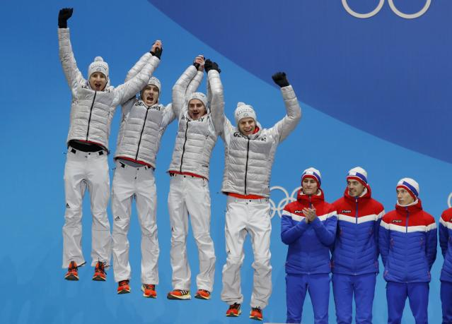 Medals Ceremony - Ski Jumping - Pyeongchang 2018 Winter Olympics - Men's Team - Medals Plaza - Pyeongchang, South Korea - February 20, 2018 - Silver medalists Karl Geiger, Stephan Leyhe, Richard Freitag and Andreas Wellinger of Germany on the podium. REUTERS/Eric Gaillard