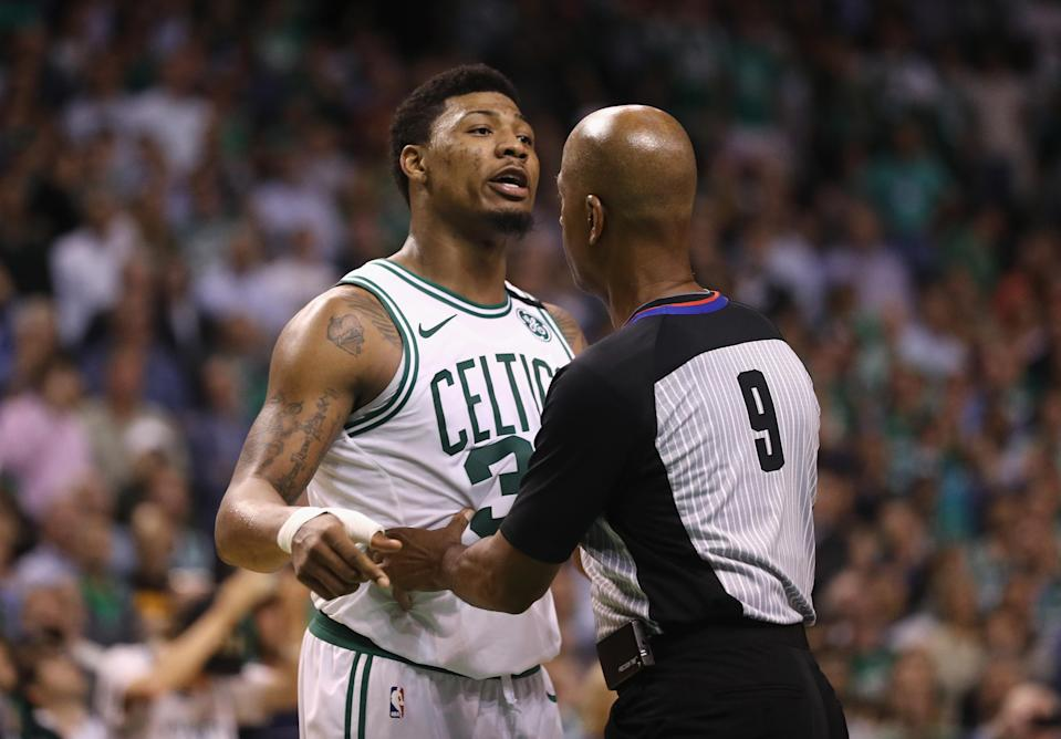 """<a class=""""link rapid-noclick-resp"""" href=""""/nba/players/5317/"""" data-ylk=""""slk:Marcus Smart"""">Marcus Smart</a> and <a class=""""link rapid-noclick-resp"""" href=""""/nba/players/3835/"""" data-ylk=""""slk:J.R. Smith"""">J.R. Smith</a> went at it Saturday as bitterness from last year's Eastern Conference finals has apparently held over. (Getty)"""