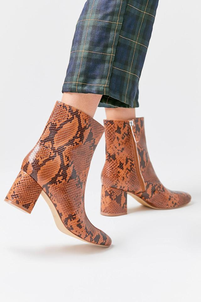 """<p>The print on these <a href=""""https://www.popsugar.com/buy/UO-Alana-Snakeskin-Boots-489668?p_name=UO%20Alana%20Snakeskin%20Boots&retailer=urbanoutfitters.com&pid=489668&price=79&evar1=fab%3Aus&evar9=45214624&evar98=https%3A%2F%2Fwww.popsugar.com%2Ffashion%2Fphoto-gallery%2F45214624%2Fimage%2F46603089%2FUO-Alana-Snakeskin-Boots&list1=shopping%2Cfall%20fashion%2Cshoes%2Cboots%2Cfall%2Cwinter%2Cwinter%20fashion&prop13=mobile&pdata=1"""" rel=""""nofollow"""" data-shoppable-link=""""1"""" target=""""_blank"""" class=""""ga-track"""" data-ga-category=""""Related"""" data-ga-label=""""https://www.urbanoutfitters.com/shop/uo-alana-snakeskin-boot?category=boots-for-women&amp;color=020&amp;type=REGULAR&amp;quantity=1"""" data-ga-action=""""In-Line Links"""">UO Alana Snakeskin Boots</a> ($79) sold us.</p>"""