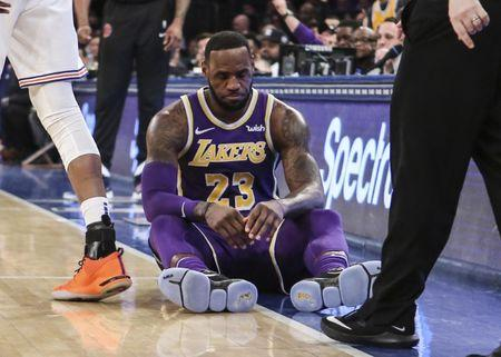 FILE PHOTO: Mar 17, 2019; New York, NY, USA;  Los Angeles Lakers forward LeBron James (23) sits on the court after getting fouled in the second quarter against the New York Knicks at Madison Square Garden. Mandatory Credit: Wendell Cruz-USA TODAY Sports