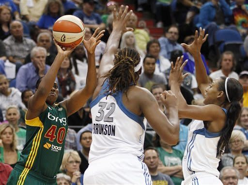 Seattle Storm guard Shekinna Stricklen (40) takes a shot against Minnesota Lynx forward Rebekkah Brunson (32) and guard Candice Wiggins during the second half of Game 1 of the WNBA basketball first-round playoff series Friday, Sept. 28, 2012, in Minneapolis. The Lynx won 78-70. (AP Photo/Stacy Bengs)