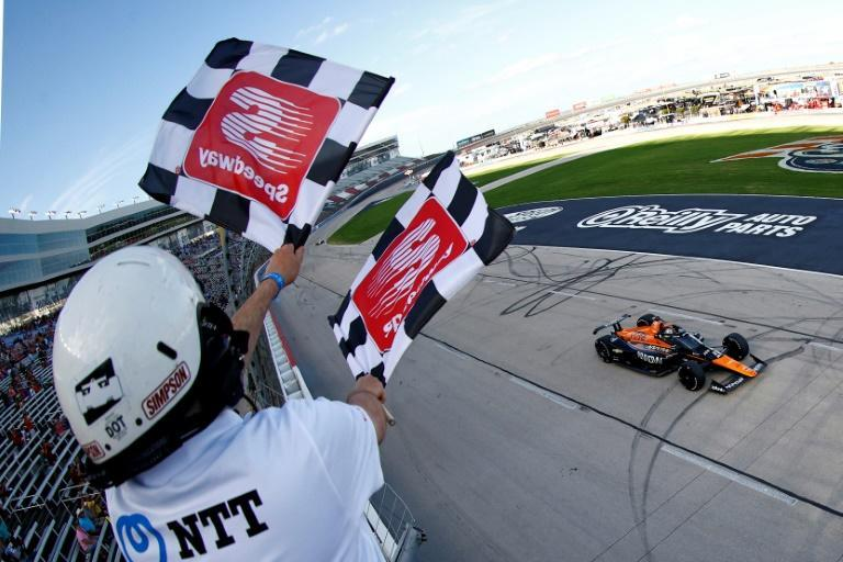 Mexico's Pato O'Ward takes the chequered flag at Texas Motor Speedway for his first IndyCar win