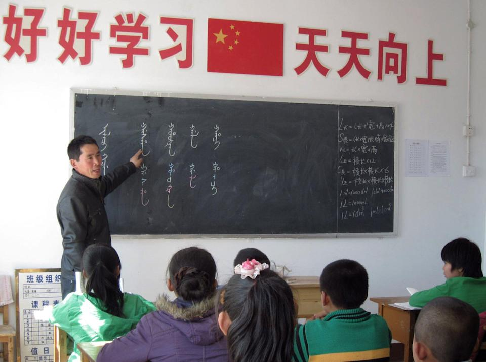 Village school pupils learn Manchu script in Sanjiazi, Fuyu county, Heilongjiang. Linguists fear that Manchu, an endangered language, will die out when the last native speakers of Manchu, now in their 70s and 80s, die. Photo: SCMP
