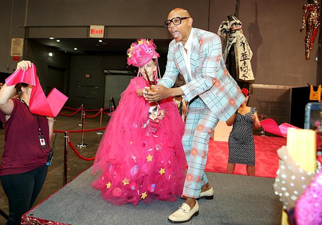 <p>RuPaul cut the ribbon for the opening of the first RuPaul's DragCon NYC, an all-ages, family-friendly celebration of drag culture, alongside 10-year-old Desmond is Amazing, one of the two-day event's many featured guests. (Photo: World of Wonder) </p>