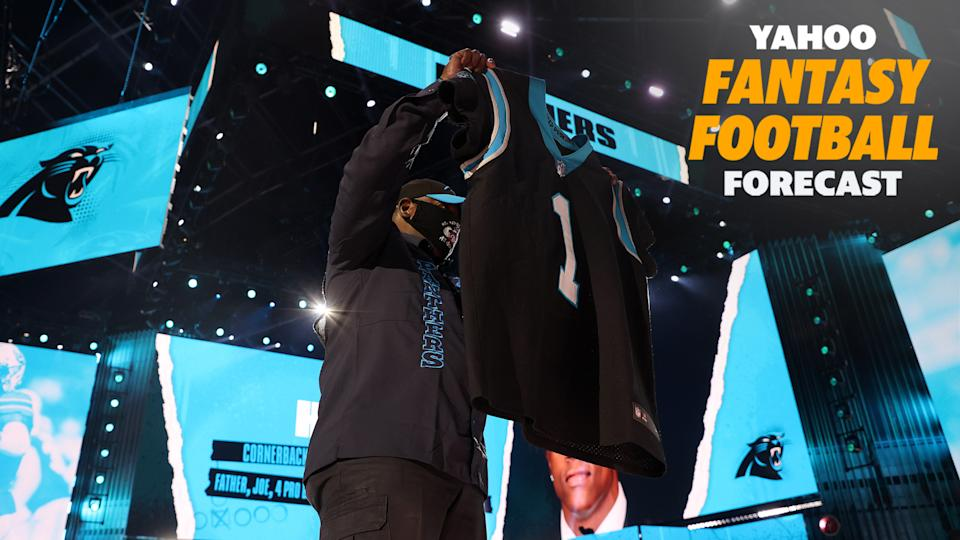 A fan holds up a Carolina Panthers jersey at the 2021 NFL Draft. (Photo by Gregory Shamus/Getty Images)