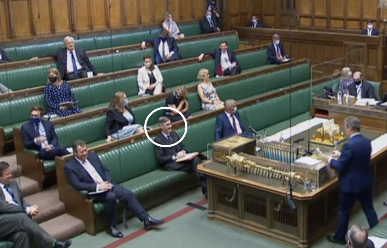 Jacob Rees-Mogg, circled, did not wear a face mask during PMQs on Wednesday. (Parliamentlive.tv)