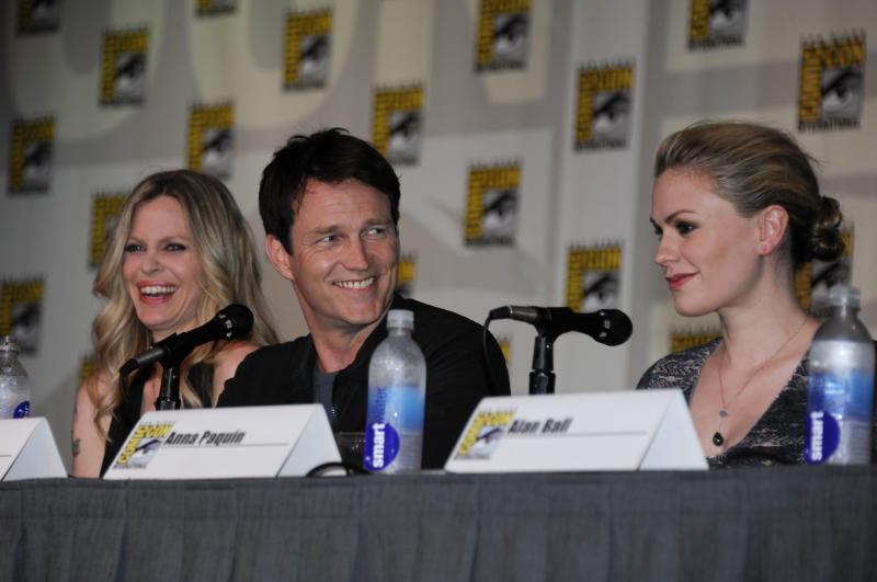 Actor Stephen Moyer, center, speaks as actress Kristin Bauer van Straten, left, and actress Anna Paquin look on at the True Blood panel on the third day of Comic-Con convention held at the San Diego Convention Center on Saturday, July 14, 2012, in San Diego. (Photo by Denis Poroy/Invision/AP)